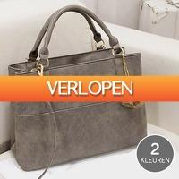 Slimmedealtjes.nl: Nubuck handtas met fluffy pom hanger