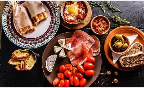 Social Deal: 3-gangen keuzediner of tapasdiner + dessert bij La Puerta