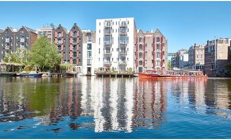 Groupon: Amsterdam - slapen & diner: kamer voor 2 met ontbijt, naar keuze pizza